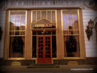 Gostei particularmente desta, que retrata a entrada da pastelaria Gerbeaud. Eu não a fotografei quando lá estive, mas escrevi sobre ela aqui: https://cartografiapessoal.wordpress.com/2012/01/29/um-sitio-em-pest/ ]